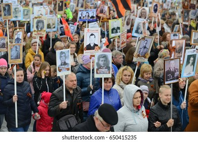 Orel, Russia - may 9, 2017: the Victory Day holiday. A large crowd of people, carrying red Soviet flags and portraits of the ancestors of the hero to take part in the Immortal regiment