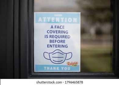 OREM, UTAH, USA - August 14, 2020: Exterior door sign at Mountain View High School, part of Alpine School District, reminds all to wear face coverings