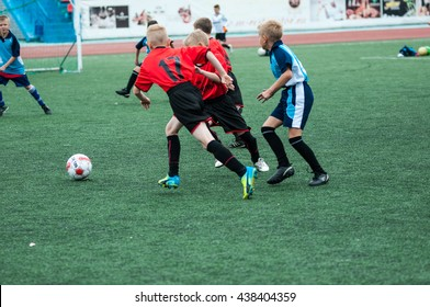 "Orenburg, Russia - 1 June 2016: The boys play football in the preliminary games football festival ""Lokobol-2016"""