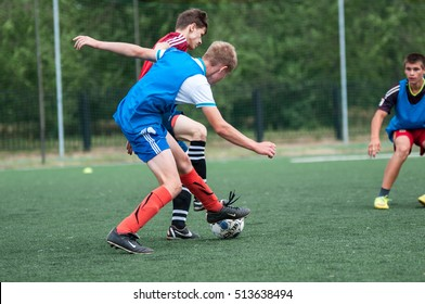 Orenburg, Russia - 9 July 2016: The boys play football at the city tournament on mini-football among childrens amateur teams memory trainer Kolosova