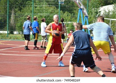 Orenburg, Russia - July 30, 2017 year: men play Street Basketball in the second round of the summer Street Basketball League