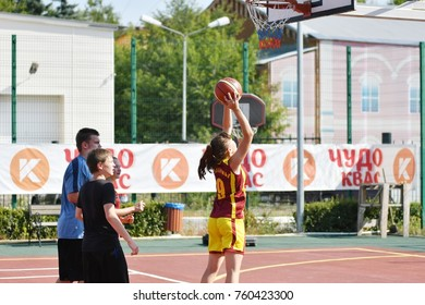 Orenburg, Russia - July 30, 2017 year: Girls and boys play Street Basketball in the second round of the summer Street Basketball League