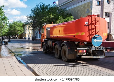 Orenburg, Russia - June, 14, 2019: Watering machine on a city street. Tank truck on the chassis of a KamAZ car