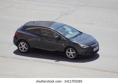 Orenburg, Russia - May 30,2019: Opel Astra GTC  rides on the road