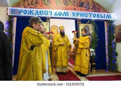 Orenburg, Russian Federation-5 Dec 2018. Orthodox priests at the Liturgy in the Church before the communion of the Holy mysteries of Christ on the background of the inscription merry Christmas