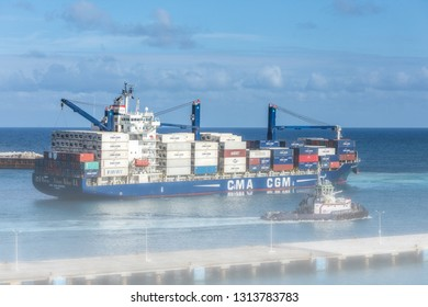 ORENJASTAD, ARUBA - May 15, 2014:: Freighters now carry most of the world's cargo and the largest container ships can carry over 21,000 units of freight.
