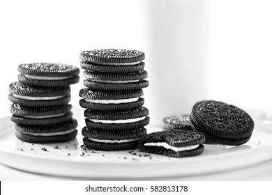 Oreo chocolate cookies stacked with milk