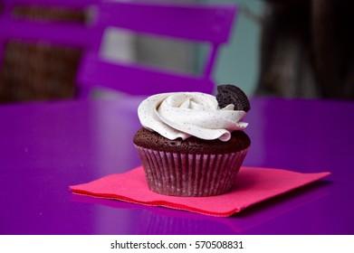 Oreo cupcake on purple table