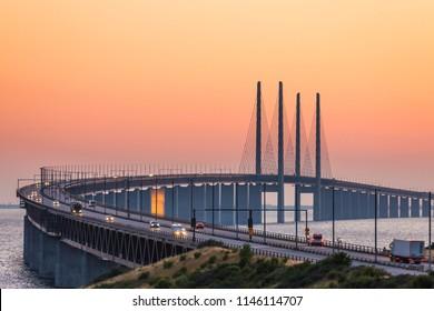 The Oresund bridge between Copenhagen Denmark and Malmo Sweden in summer sunset