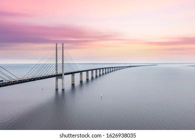 The Oresund bridge between Copenhagen Denmark and Malmo Sweden when sunset in an evening of May