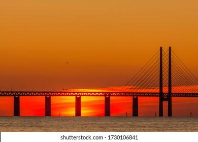 The Oresund bridge between Copenhagen Denmark and Malmo Sweden in sunset