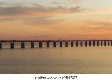 The Oresund bridge between Copenhagen Denmark and Malmo Sweden when sunset in May