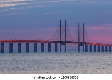 The Oresund bridge between Malmo Sweden and Copenhagen Denmark in sunset of May