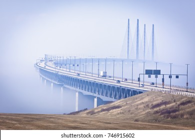 The Oresund bridge with traffic in a foggy morning in March from the Swedish side