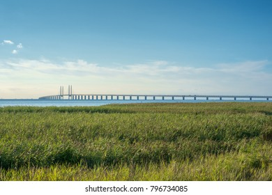 Oresund and Oresund Bridge viewed from Bunkeflostrand in Malmo, Sweden on a sunny summer day.