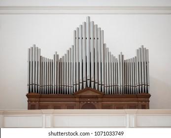 Organ above the entrance of an italian church.