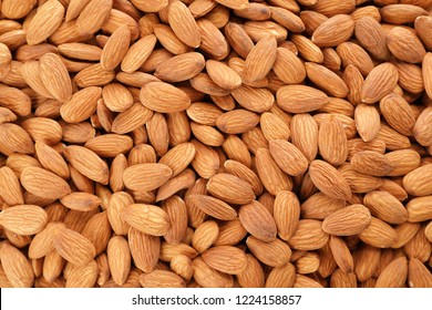 Organic almond nuts as background, top view. Healthy snack