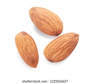 Organic almond nuts on white background, top view. Healthy snack