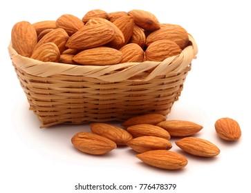 Organic almonds over white background