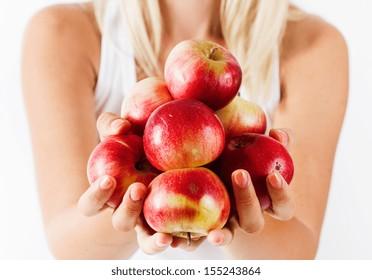 Organic apple in human hands.