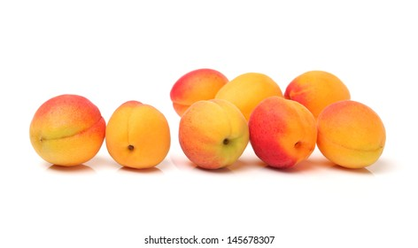 Organic apricots isolated on white