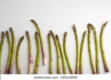 Organic asparagus on white wood