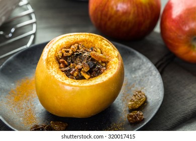 Organic baked apples with raisins and pecans. - Shutterstock ID 320017415