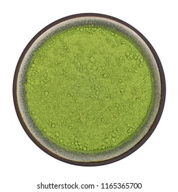 Organic barleygrass powder in ceramic bowl isolated on white background, top view