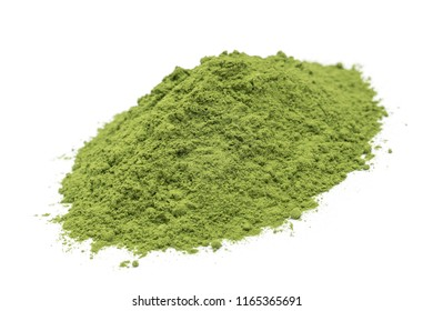 Organic barleygrass powder isolated on white background, dutch angle view