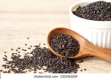 organic Black  sesame seeds in wooden spoon ,healthy food for reductions in both systolic and diastolic blood pressure