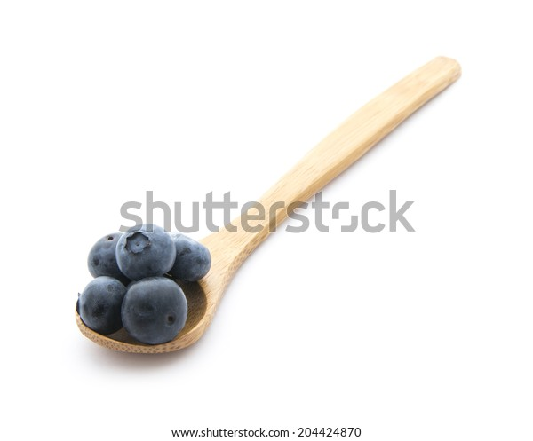 organic blueberries on wooden spoon isolated on white background