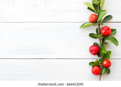 organic brazilian acerola cherry on white wooden table