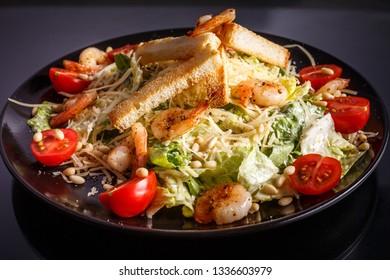 Organic caesar salad with caesar dressing. International food.
