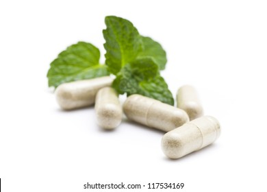 Organic capsule with mint leaves