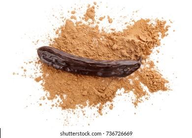 Organic carob bean and carob powder from above.