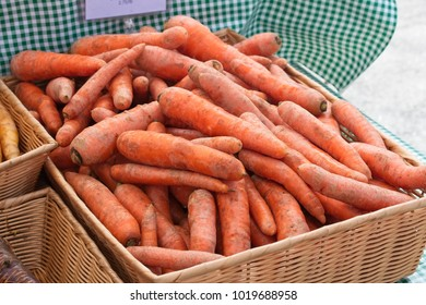 organic carrots sold at a farmers market