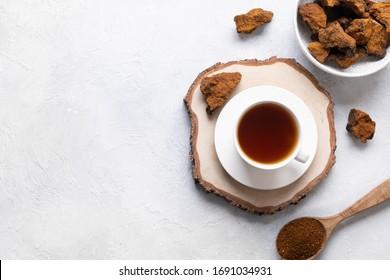 Organic Chaga mushroom coffee on light background. Top view. Horizontal. Copy space.