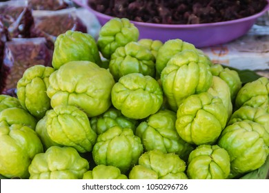 Organic Chayote fruits for sale in the market. Chayote (Sechium edule) is an edible plant that also known as christophine, cho-cho, sayote, pipinola, pear squash, vegetable pear and choko.