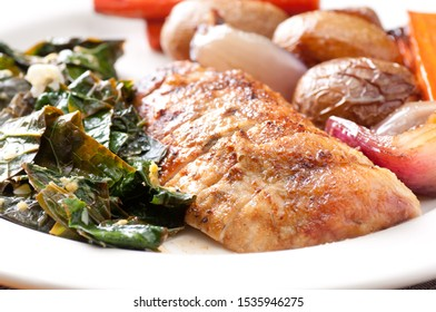organic chicken dinner with vegetables and kale