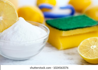 Organic cleaners, lemon and baking soda on wooden table