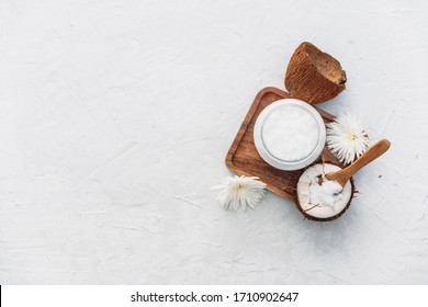 Organic coconut and wooden spoon. Coconut body care concept
