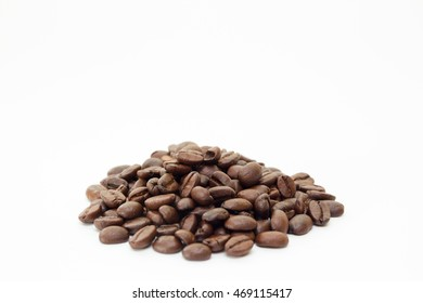 Organic coffee beans on white background close up isolated.