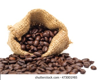 Organic coffee beans in sack on white background close up isolated.