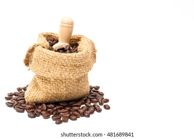 Organic coffee beans in sack on white background close up isolated.(Droped space on right side for text and other.)