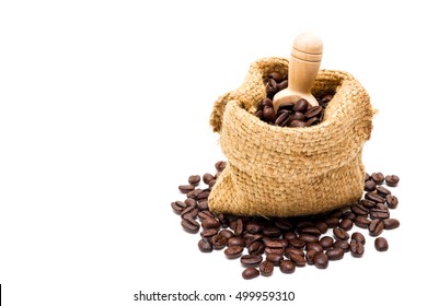 Organic coffee beans in sack on white background close up isolated.(Droped space on left side for text and other.)