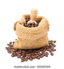 Organic coffee beans and wooden coffee dipper on white background close up isolated.