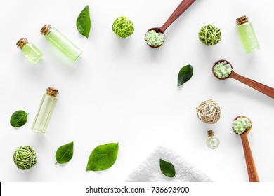 organic cosmetic set with tea olive oil and sea salt in bottle white table background flat lay frame mockup