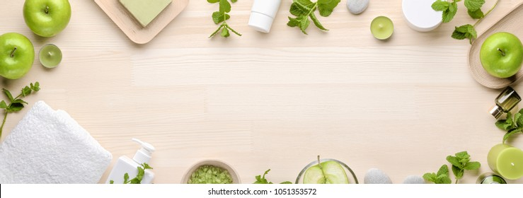 organic cosmetics with apple and mint leaf, top view