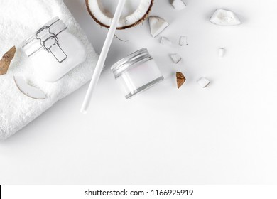 organic cosmetics with coconut on white background top view mock