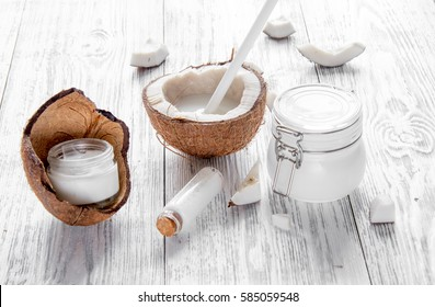 organic cosmetics with coconut on wooden background close up